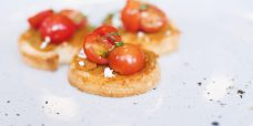 herb crostini with spicy eggplant, tomato, fetta and pasley